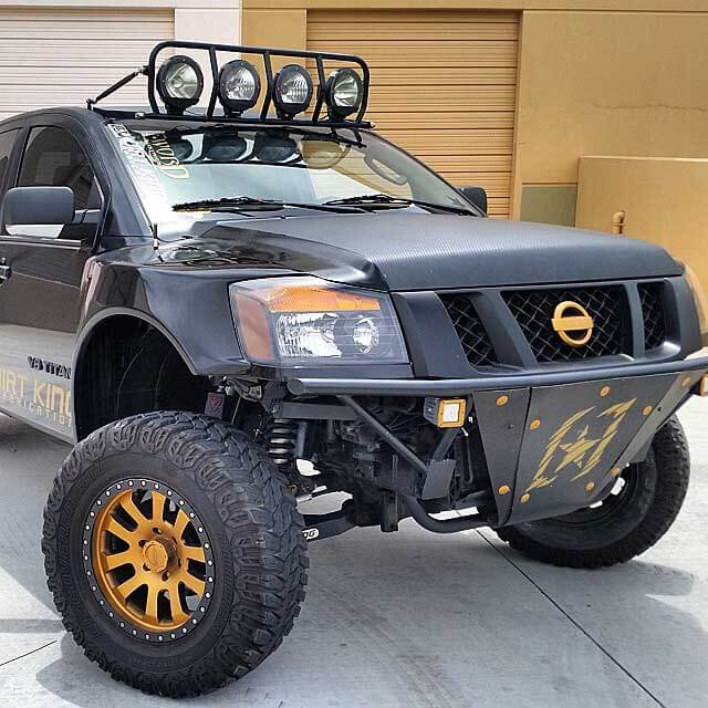 Nissan Titan prerunner with gold wheels
