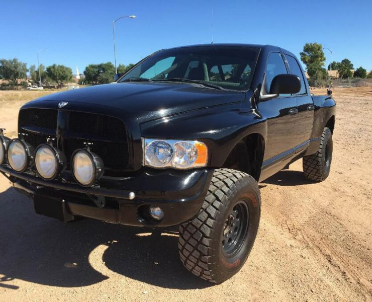 Dodge ram prerunner black with lightbar