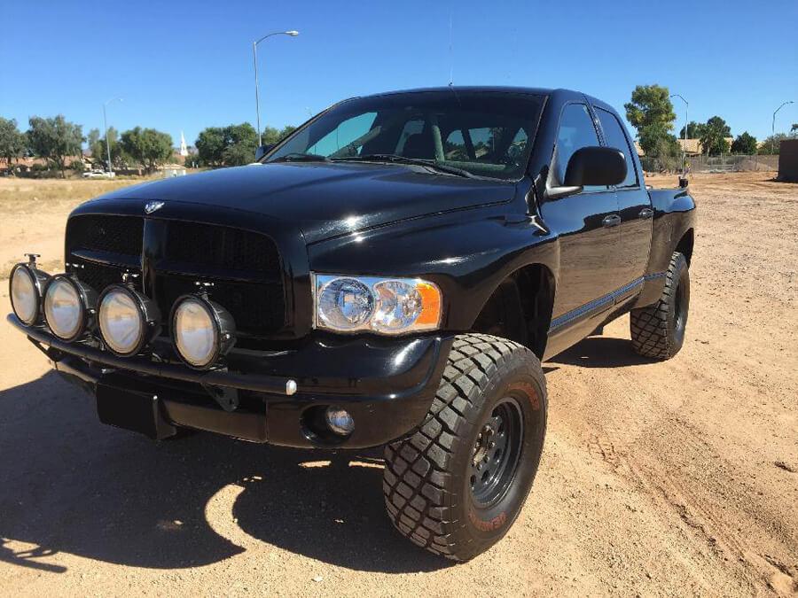 Dodge ram prerunner black with lightbar