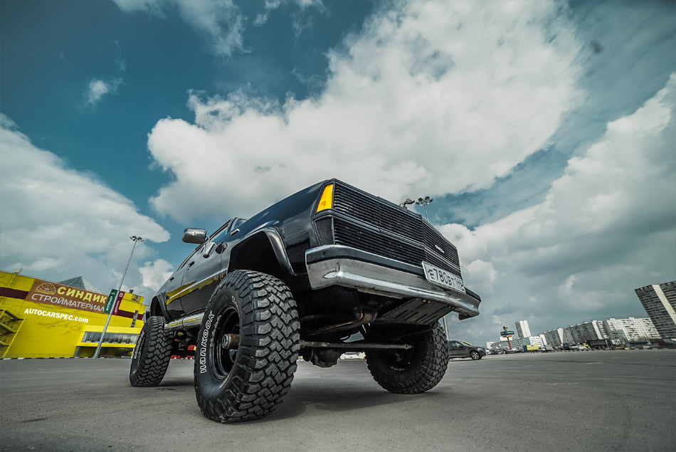 Lifted sedan on off-road wheels