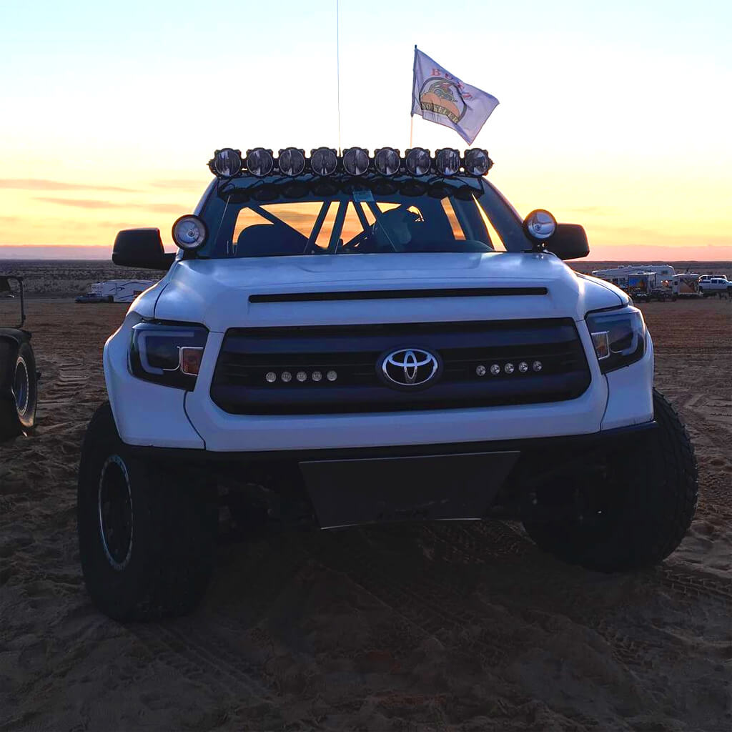 White Toyota Tundra with Spyder Black U-Bar Projector LED Headlights
