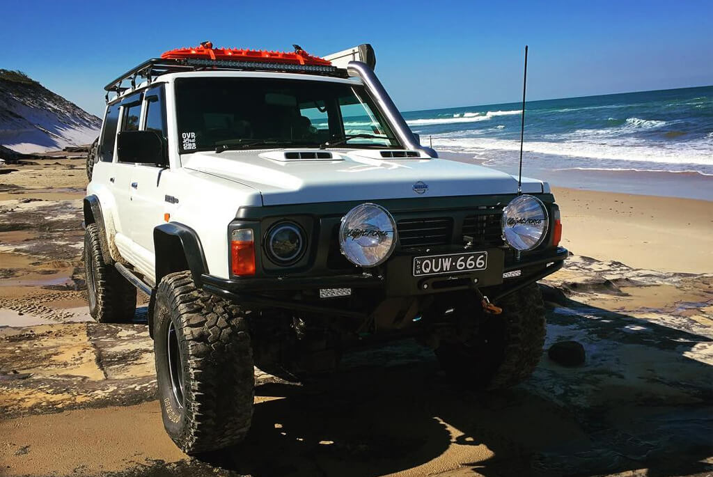White Nissan Patrol Y60 off-road modifications