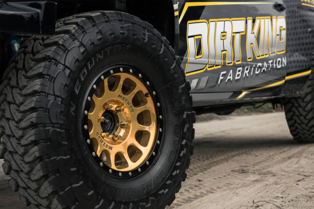 Custom Painted Black and Gold Method Racing Wheels on Chevy Prerunner
