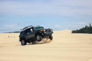 Lifted Toyota fj cruiser jumping dunes