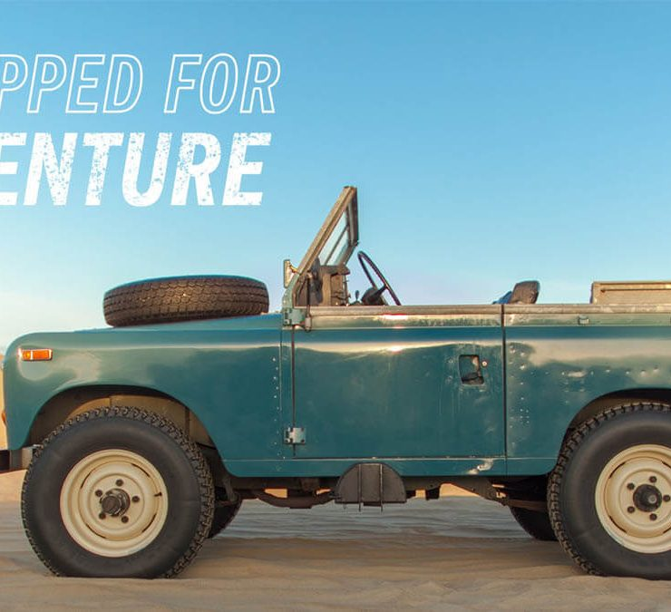 Land rover series III with a tire on the hood