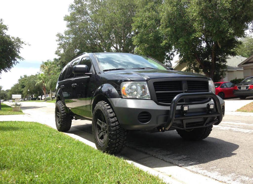2nd gen dodge durango with big wheels and off-road mods