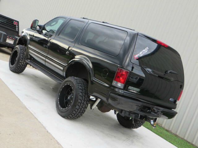 Black lifted ford excursion with offroad mods