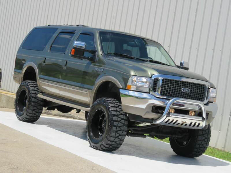 Lifted Ford Excursion mud tires with 20 inch rims
