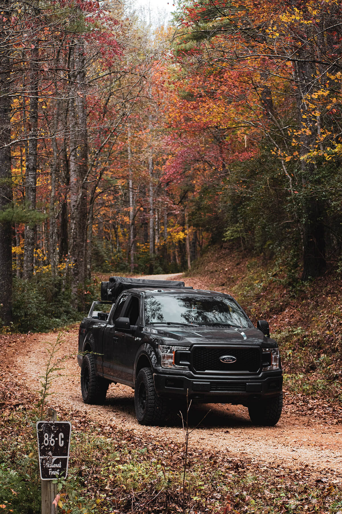 """black 2019 Ford F150 with 5 inch lift and 33"""" off-road tires"""