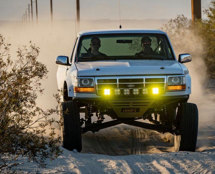 Ford F150 prerunner racing in the desert
