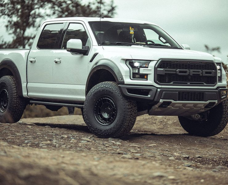 White ford Raptor on Black Off-road wheels