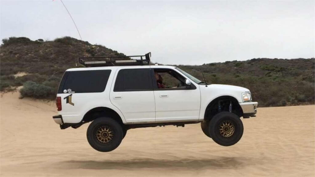 Ford Expedition prernner jumping in the air