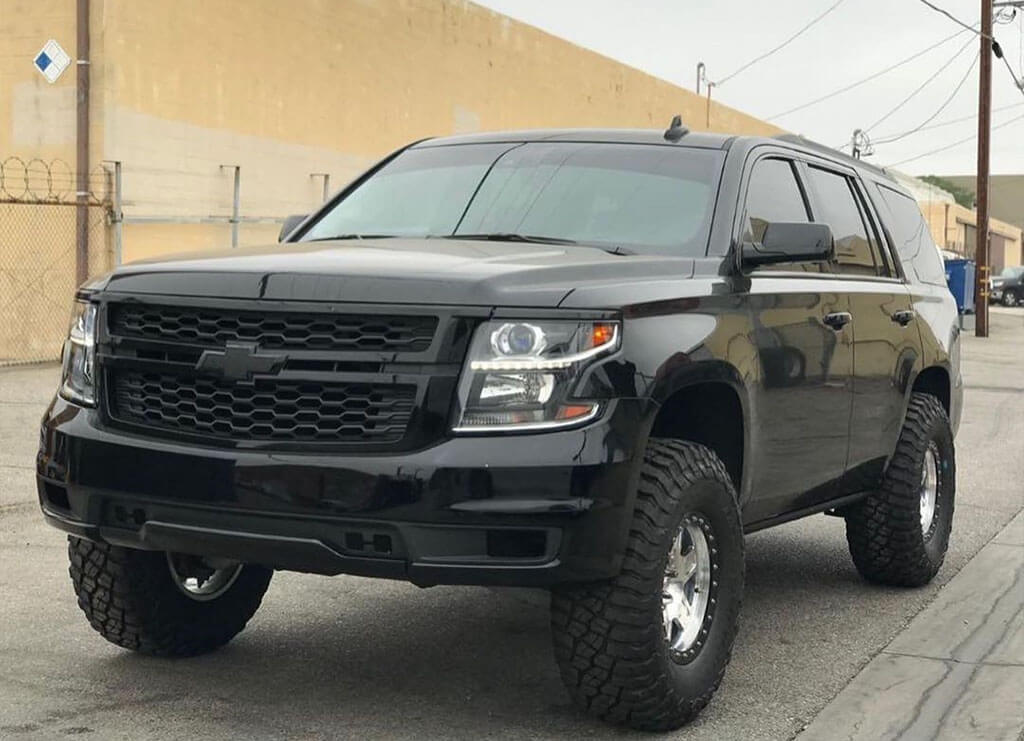 Modified Chevy Tahoe on 35s with all black Grille