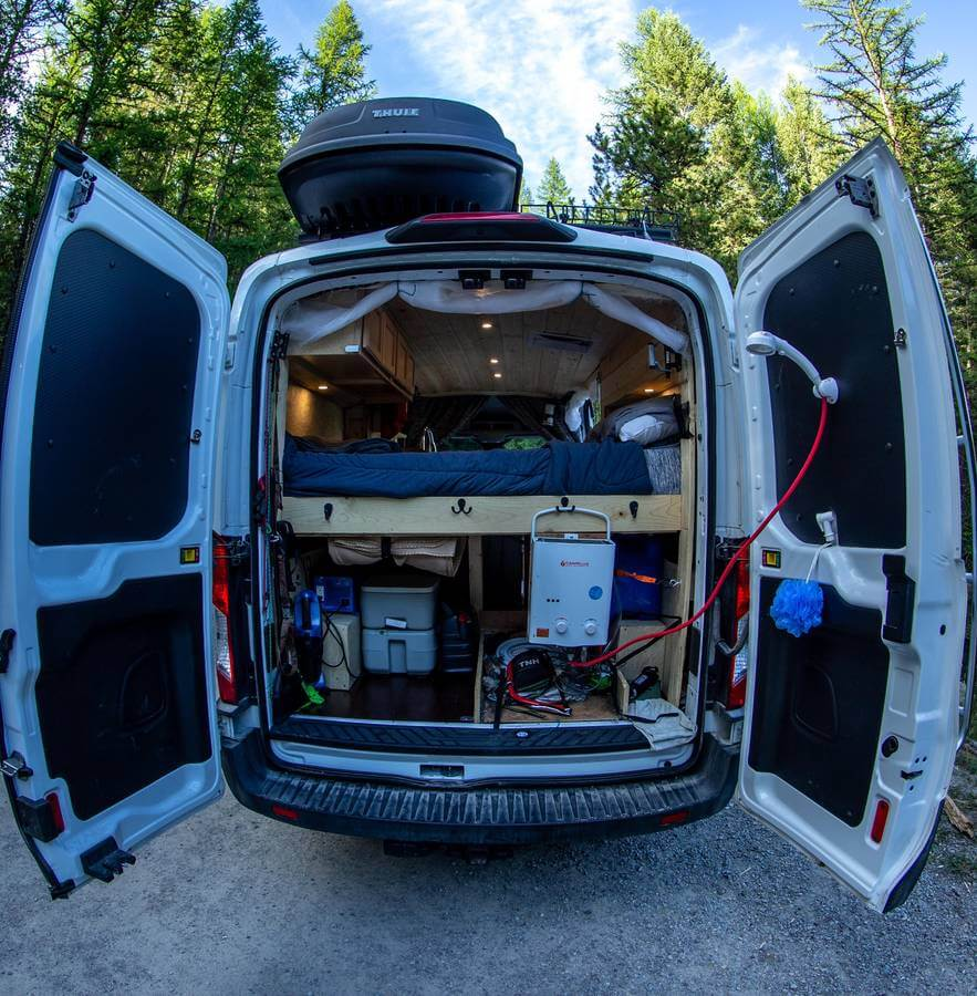 Overland gear in Ford Transit with hot shower