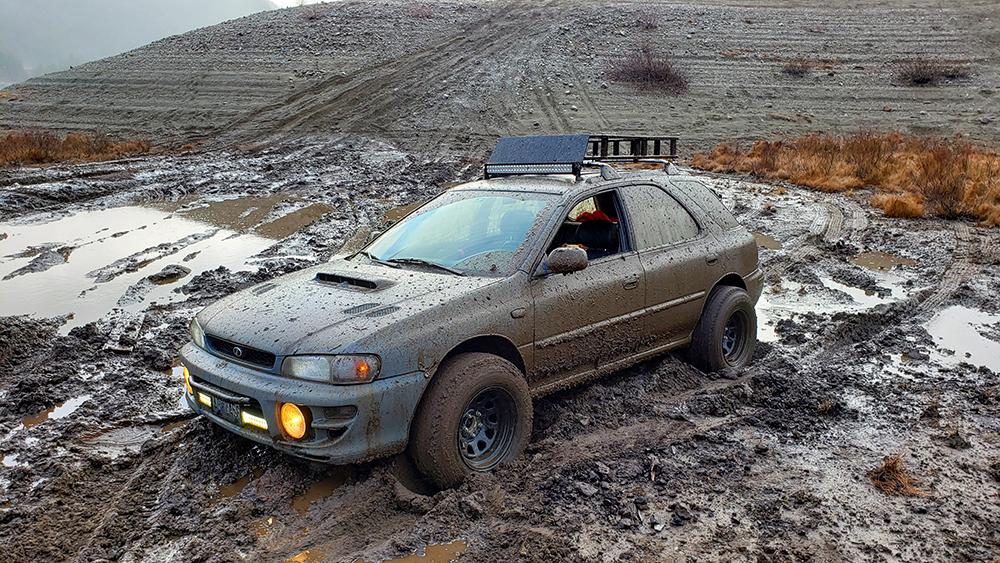Lifted Subaru Impreza Wgon in the mud