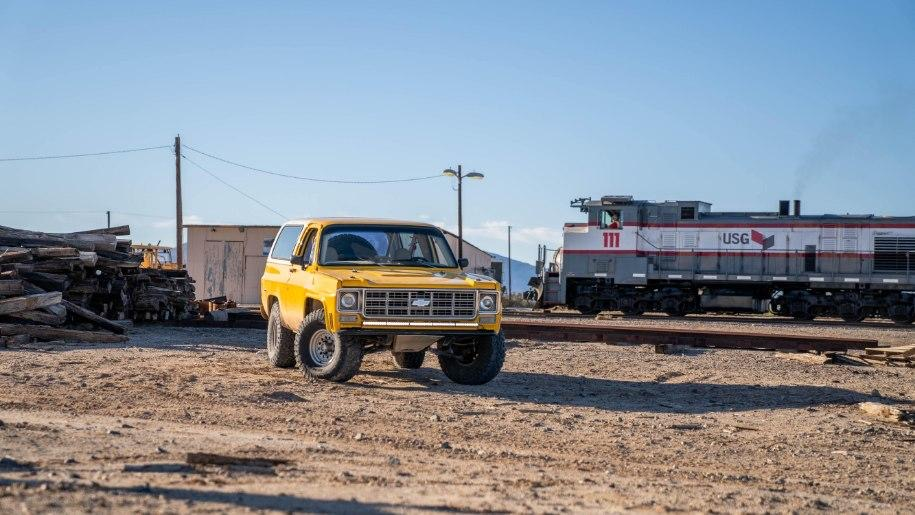Yellow chevy k5 pre runner on 35×12.50 General Grabber off-road tires