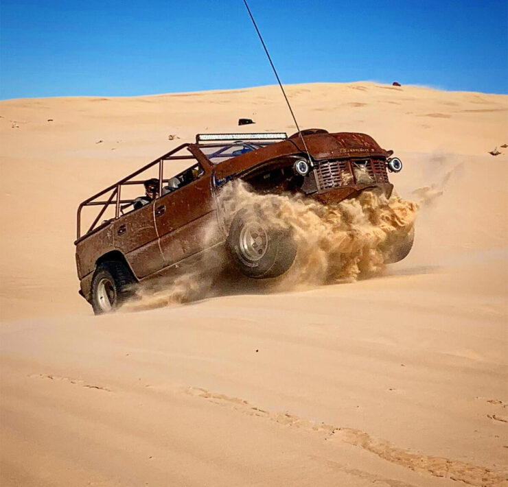 Jumbing dunes in a rat rod buggy