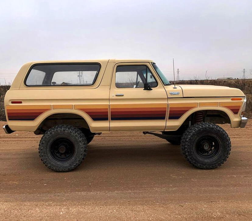 Full size Ford Bronco with a lift and mud tires