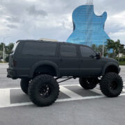 Ford Excursion 10 inch lift and custom suspension modifications