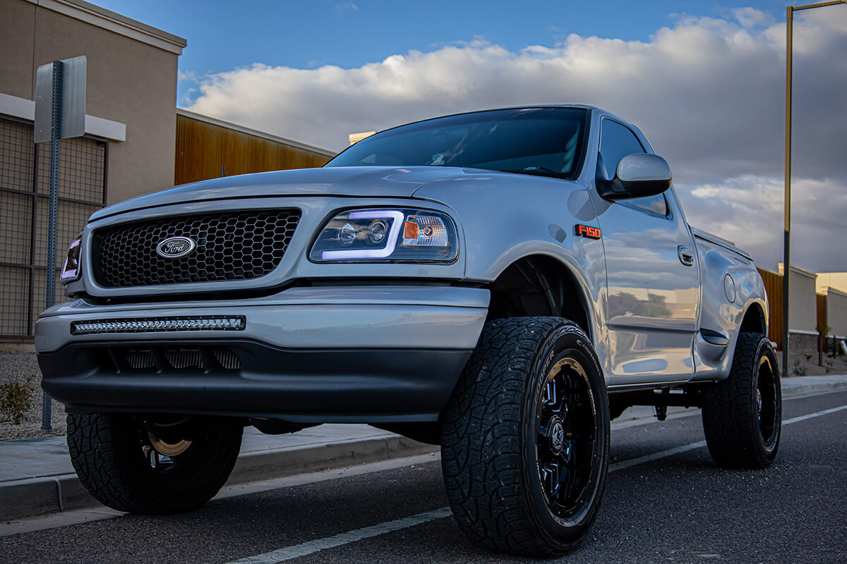 "Modified 10th gen Ford F150 lightning with a 5"" lift"