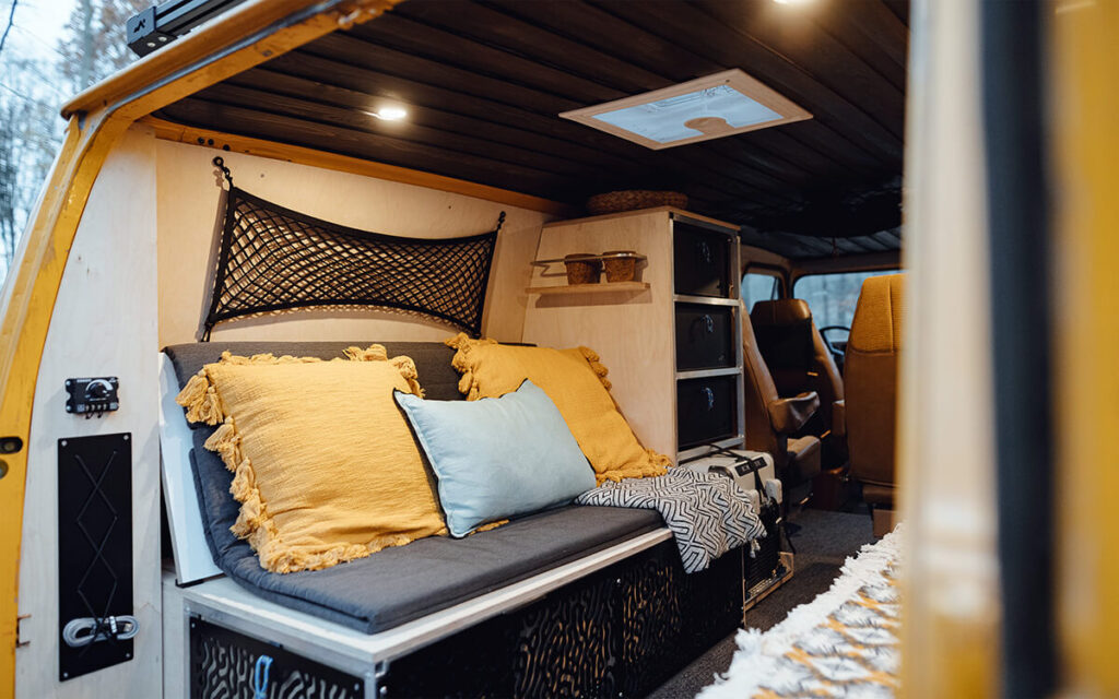 Custom bed and kitchen in a van