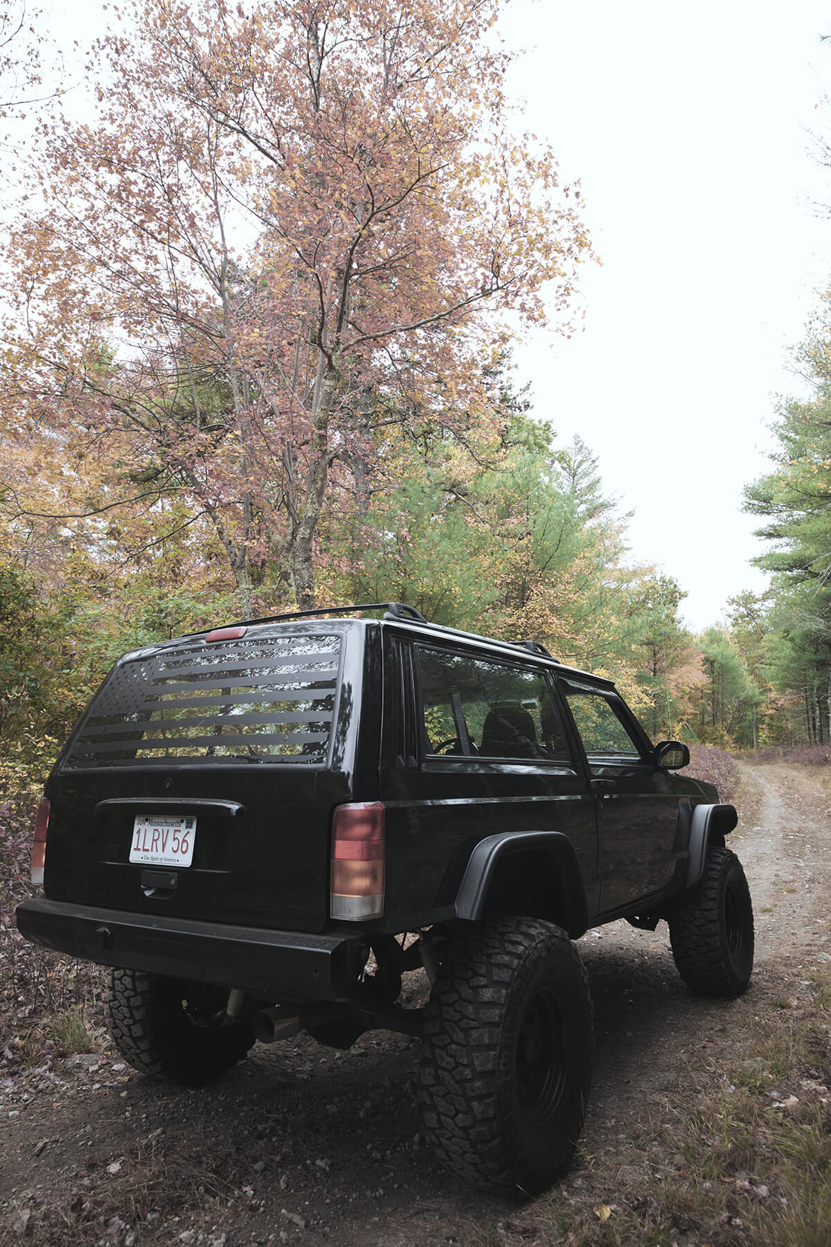 Black Jeep Cherokee XJ with bushwacker fender flares - rear view