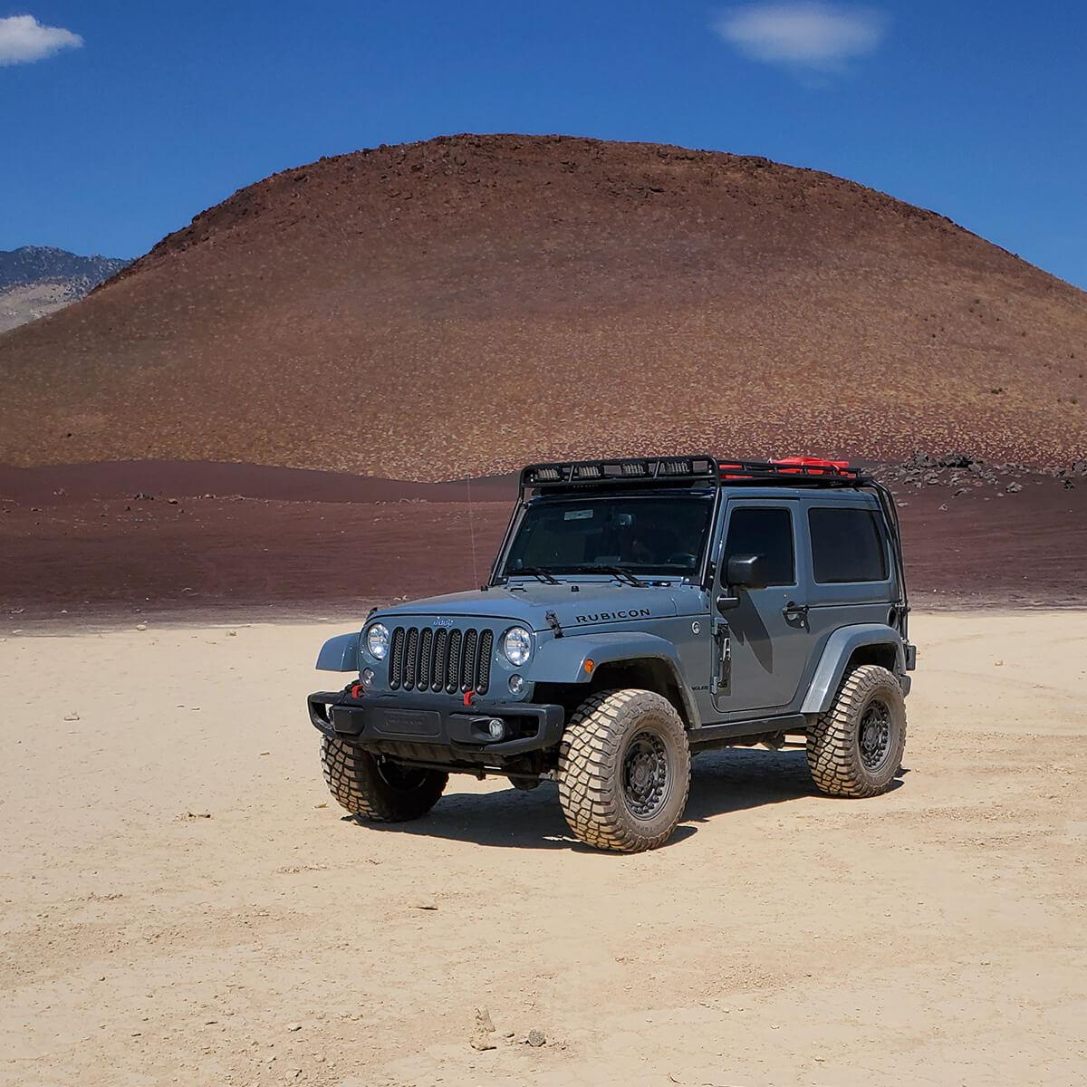 Light blue lifted jeep Wrangler rubicon in the desert sands