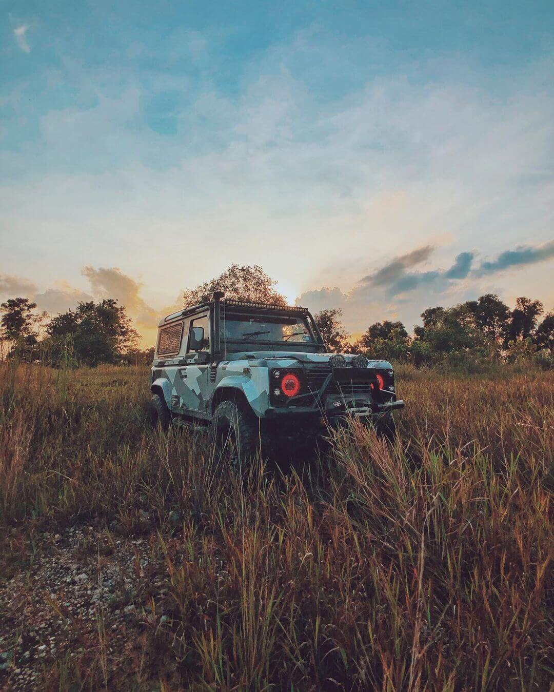 Lifted 2006 Land Rover Defender 90 with overland style modifications