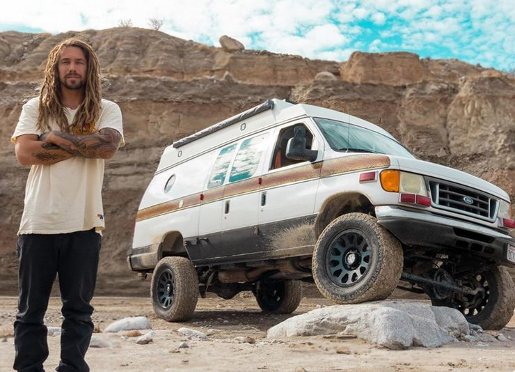 """Ford E350 Overland Camper van with a 6 inch lift and 35"""" tires"""