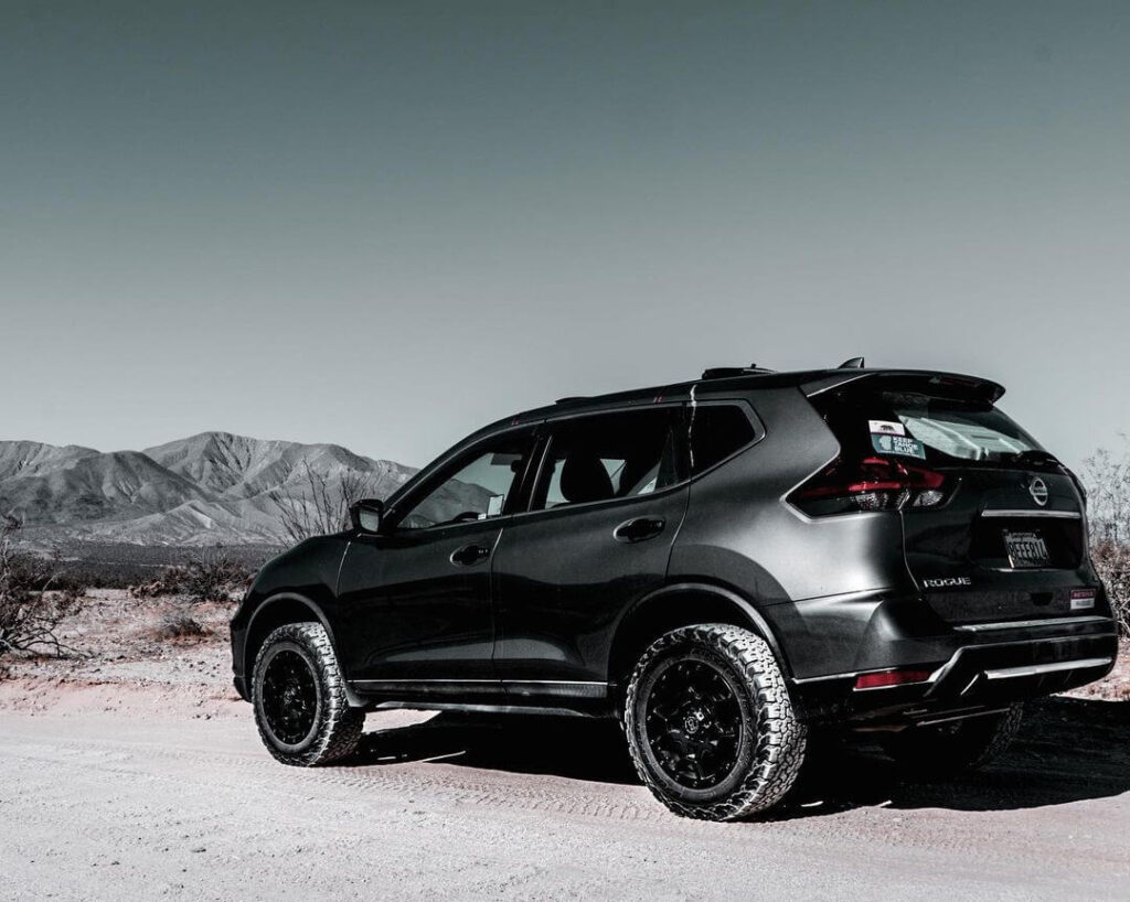 Lifted Nissan Rogue with off-road wheels