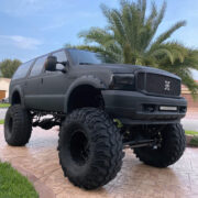 """Lifted 2004 Ford Excursion Monster Truck On 49"""" Super Swampers"""