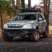 Silver Subaru Forester With off-road modifications