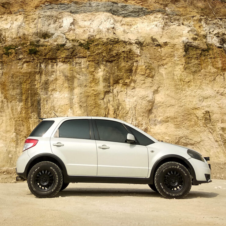 Lifted Suzuki SX4 With off-road wheels
