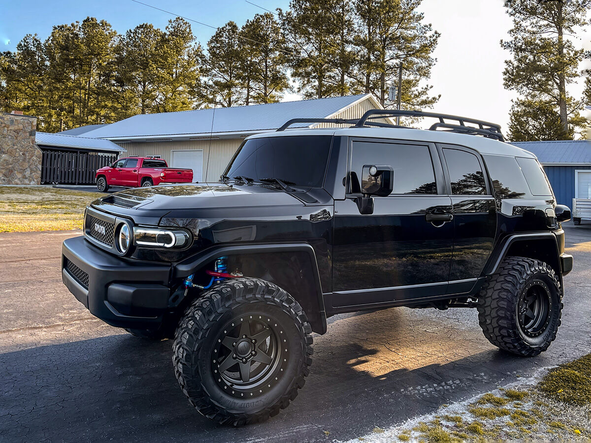 Black Toyota FJ-cruiser with a lift and 33x12.5 tires