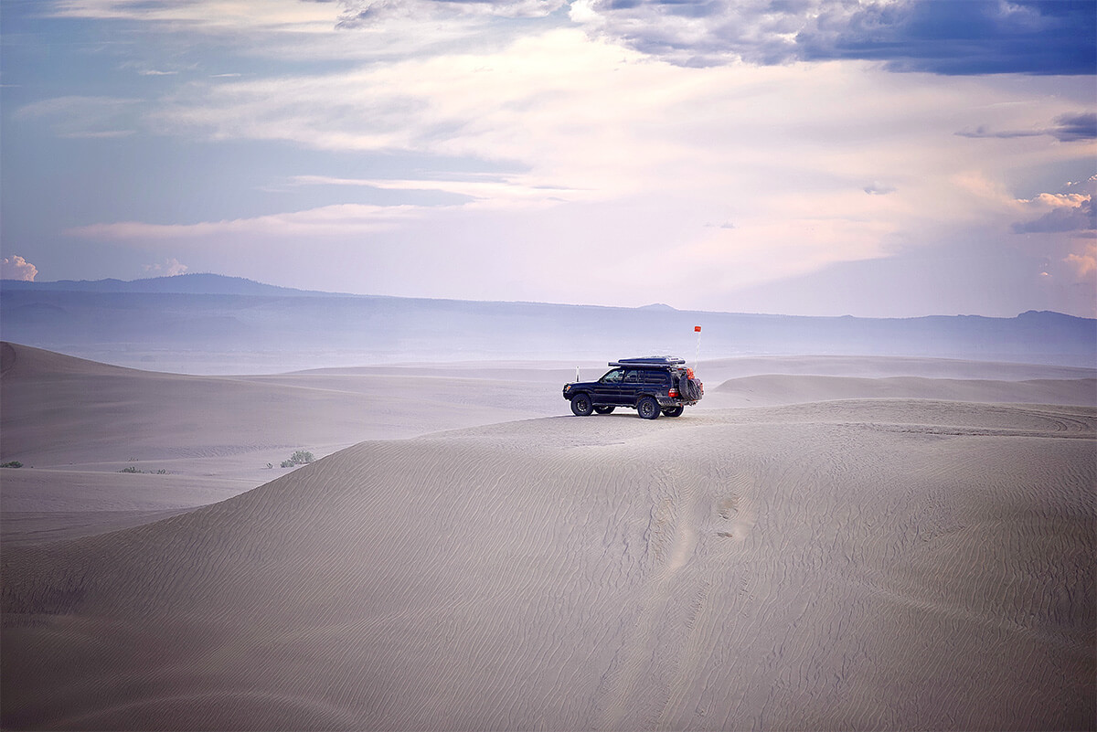 Toyota land cruiser in the desert and sand dunes