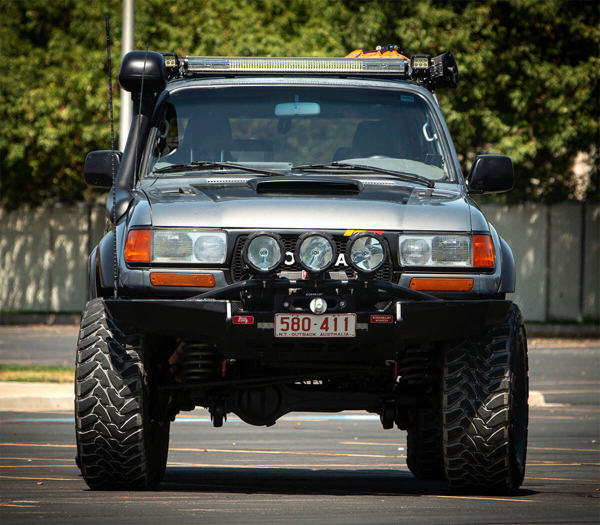 Toyota Land Cruiser 80 with a snorkel and LED lightbar