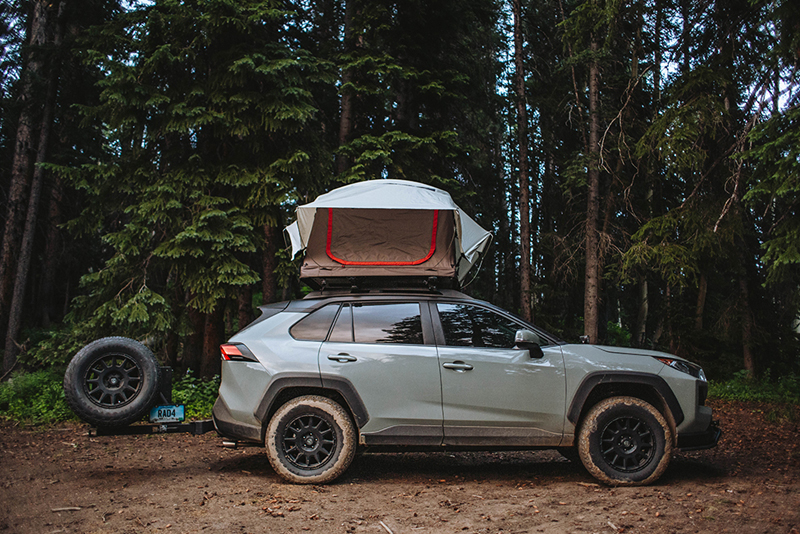 lifted rav4 with a roof top tent