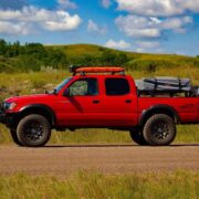 Yakima roof rack with pelican vault case and traction boards