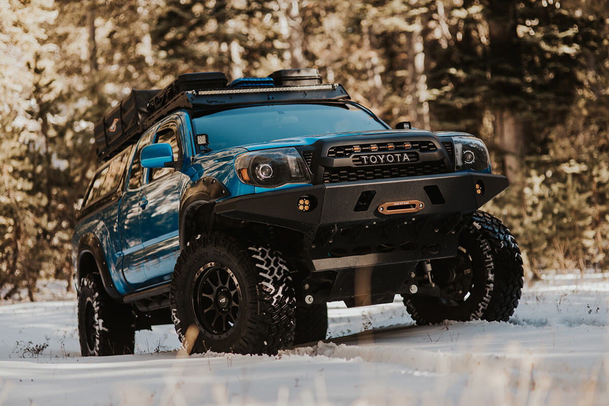 Dv8 offroad front bumper and custom headlights by Spyder