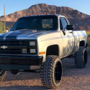 lifted chevy squarebody truck with 24x14 rims