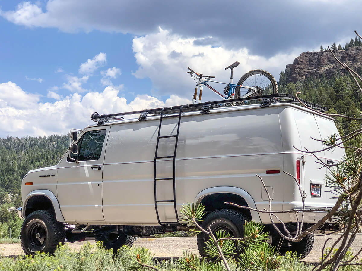 Ford E150 Van with Overland roof rack, ledder, and bike carrier