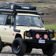 Tan Mitsubishi Montero with a 3 inch lift and off-road accessories