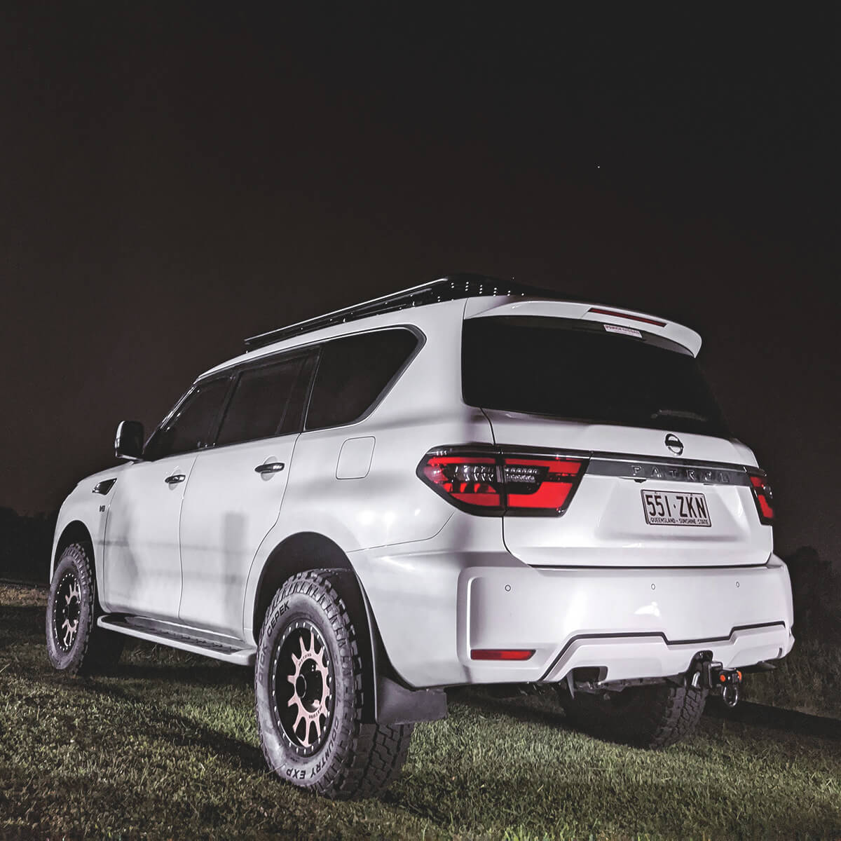 White 2019 Nissan Patrol Y62 with off-road modifications for Overlanding
