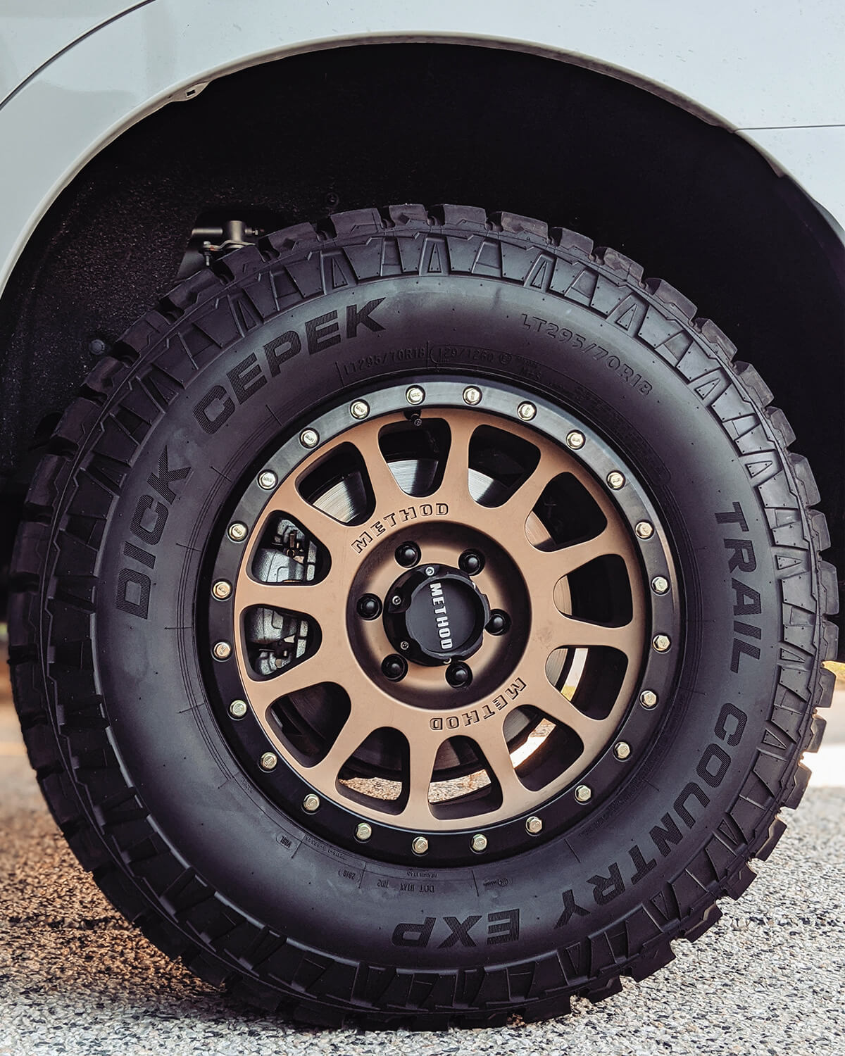 """Method race wheels 305NV in Satin bronze 18 x 9"""" +18mm offset – Dick Cepek Trail country EXP (A/T) tires 295/70/R18 (34.5″)"""