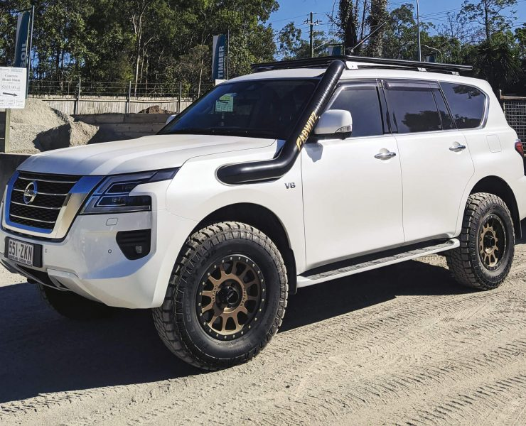 """2"""" Lifted Nissan Patrol Y62 on Method rims and 34"""" A/T off-road tires"""
