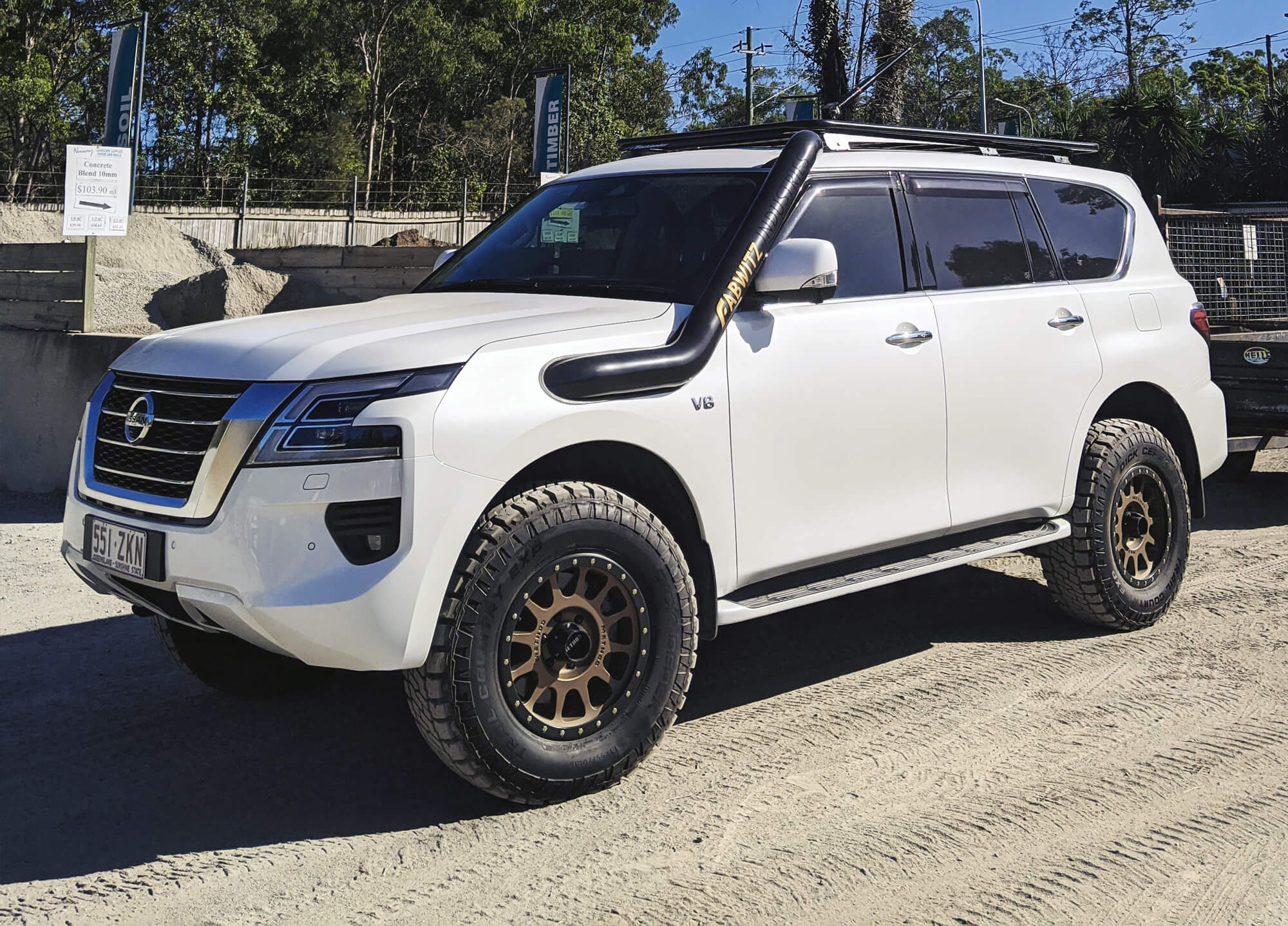 "2"" Lifted Nissan Patrol Y62 on Method rims and 34"" A/T off-road tires"