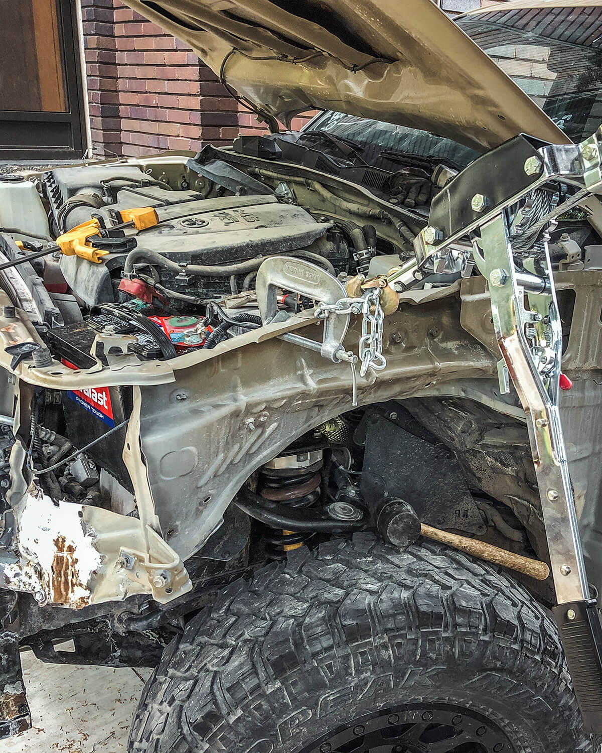 Totaled toyota tacoma truck with a body damage